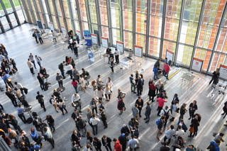 Attendees networking at SwissTech Convention Centre