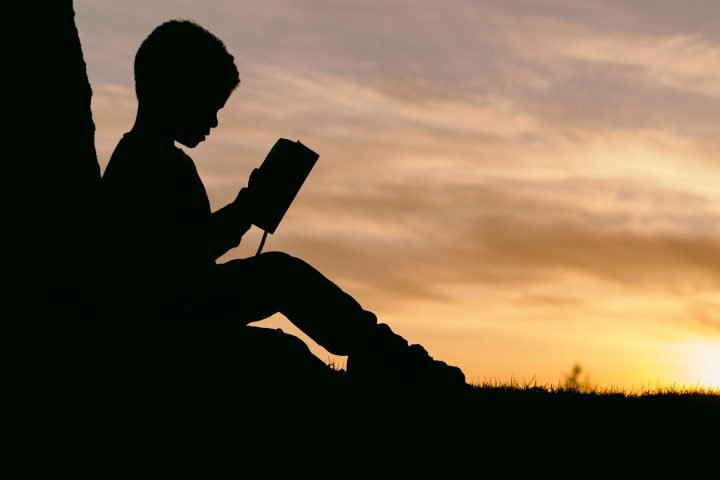 Kid Reading Silhouette